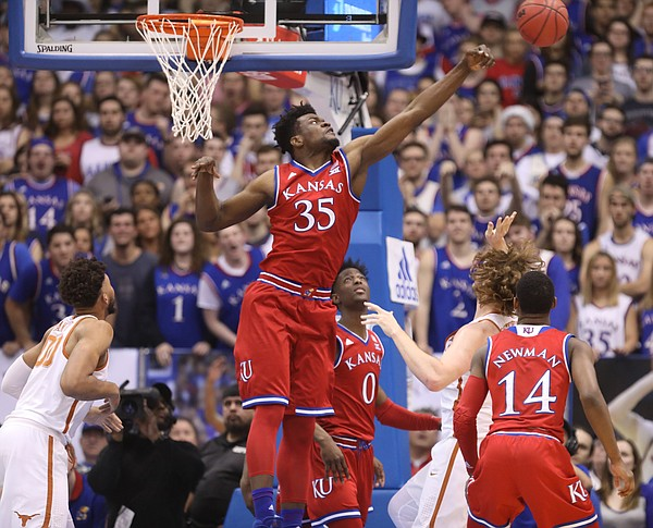 Kansas center Udoka Azubuike (35) gets up to reject a shot from Texas forward Dylan Osetkowski (21) during the first half on Monday, Feb. 26, 2018 at Allen Fieldhouse.