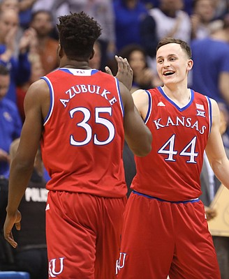 Kansas forward Mitch Lightfoot (44) celebrates with Kansas center Udoka Azubuike (35) during a timeout in the first half on Monday, Feb. 26, 2018 at Allen Fieldhouse.