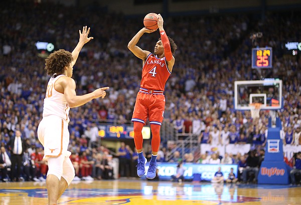 Kansas guard Devonte' Graham (4) pulls up for a three pointer during the first half on Monday, Feb. 26, 2018 at Allen Fieldhouse.