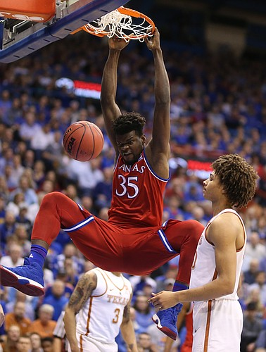 Kansas center Udoka Azubuike (35) hammers in a dunk before Texas forward Jericho Sims (20) during the first half on Monday, Feb. 26, 2018 at Allen Fieldhouse.