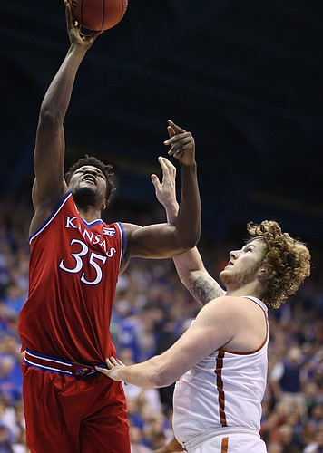 Kansas center Udoka Azubuike (35) puts a shot over Texas forward Dylan Osetkowski (21) during the second half on Monday, Feb. 26, 2018 at Allen Fieldhouse.