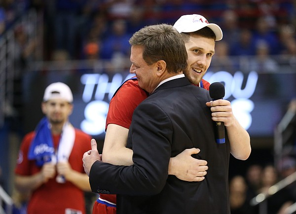 Kansas guard Sviatoslav Mykhailiuk gives a hug to Kansas head coach Bill Self before his senior speech.