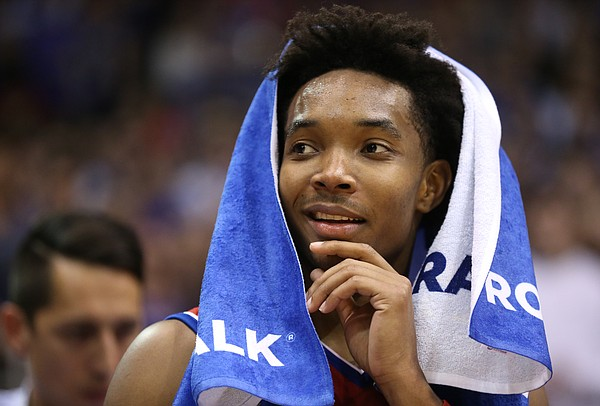 Kansas guard Devonte' Graham (4) looks out over the crowd before his senior speech.
