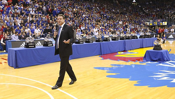 Kansas head coach Bill Self lauds his players before 14 Big 12 conference championship trophies during the celebration following their 80-70 win over Texas on Monday, Feb. 26, 2018 at Allen Fieldhouse. The win gave the Jayhawks an outright win of their 14th-straight Big 12 Conference title.