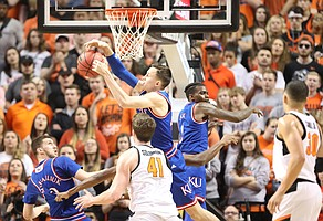 Kansas forward Mitch Lightfoot (44) pulls a rebound from Oklahoma State forward Mitchell Solomon (41) during the second half, Saturday, March 3, 2018 at Gallagher-Iba Arena, in Stillwater, Okla.