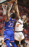 Kansas forward Silvio De Sousa (22) gets stuffed at the rim by Oklahoma State forward Cameron McGriff (12) during the second half, Saturday, March 3, 2018 at Gallagher-Iba Arena, in Stillwater, Okla.
