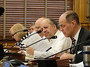 Rep. Steven Johnson, right, and Rep. Tom Sawyer, the chairman and ranking Democrat respectively on the House Taxation Committee, listen during testimony from groups opposed to raising the statewide property tax that helps fund public schools.