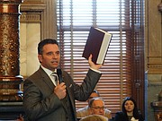 "Sen. Ty Masterson, R-Andover, holds a volume of the annotated U.S. Constitution as he argues in favor of calling a ""convention of the states"" to propose amendments reining in the power of the federal government."
