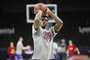Kansas forward Silvio De Sousa (22) puts up a shot during a shoot around on Wednesday, March 7, 2018 at Sprint Center in Kansas City, Mo.