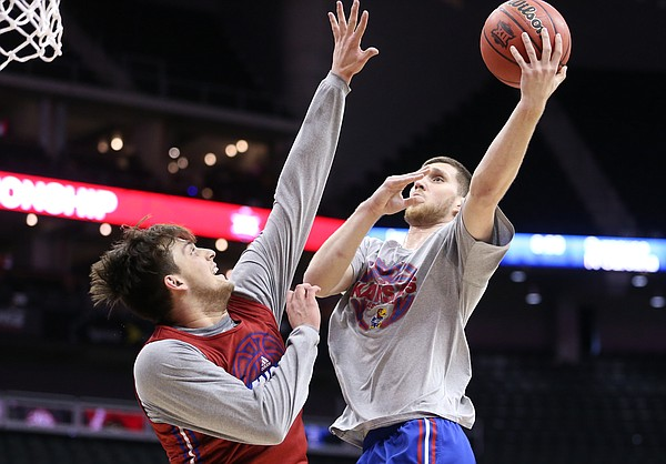 Kansas guard Sviatoslav Mykhailiuk (10) hangs for a shot over Kansas forward James Sosinski (55) during a shoot around on Wednesday, March 7, 2018 at Sprint Center in Kansas City, Mo.