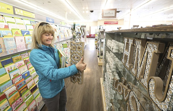 Lawrence resident Stacy Riggins looks through the Hallmark display within the Westlake Ace Hardware store at The Malls shopping center at 23rd and Louisiana streets, Wednesday, March 7, 2018.