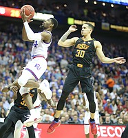 Kansas guard Malik Newman (14) gets to the bucket past Oklahoma State guard Jeffrey Carroll (30) during the first half, Thursday, March 8, 2018 at Sprint Center in Kansas City, Mo.