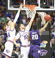 Kansas forward Mitch Lightfoot (44) and Kansas guard Sviatoslav Mykhailiuk (10) defend against a shot from Kansas State forward Xavier Sneed (20) during the first half, Friday, March 9, 2018 at Sprint Center in Kansas City, Mo.