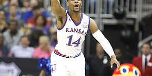 Kansas guard Malik Newman (14) signals the ball going the Jayhawks' way after a turnover by Kansas State during the first half, Friday, March 9, 2018 at Sprint Center in Kansas City, Mo.