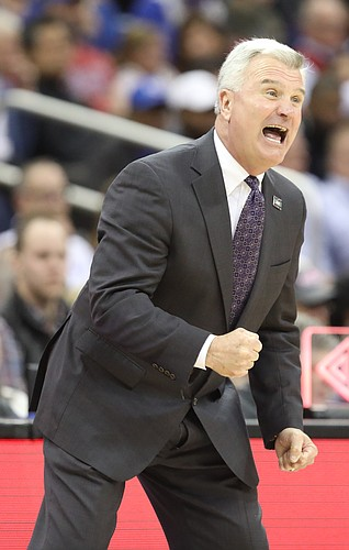 Kansas State head coach Bruce Weber gets excited during the first half, Friday, March 9, 2018 at Sprint Center in Kansas City, Mo.