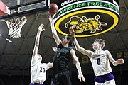 Free State senior Garrett Luinstra (3) cuts through defenders in the Firebirds' 6A state championship loss against Blue Valley Northwest on Saturday, March 10, 2018 at Charles Koch Arena in Wichita.
