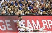 Kansas guard Malik Newman (14) encourages his teammates as he waits to check in during the first half, Saturday, March 10, 2018 at Sprint Center in Kansas City, Mo.