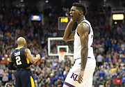 Kansas forward Silvio De Sousa (22) celebrates following the JayhawksÕ 81-70 win over the Mountaineers in the championship game of the Big 12 Tournament, Saturday, March 10, 2018 at Sprint Center in Kansas City, Mo.