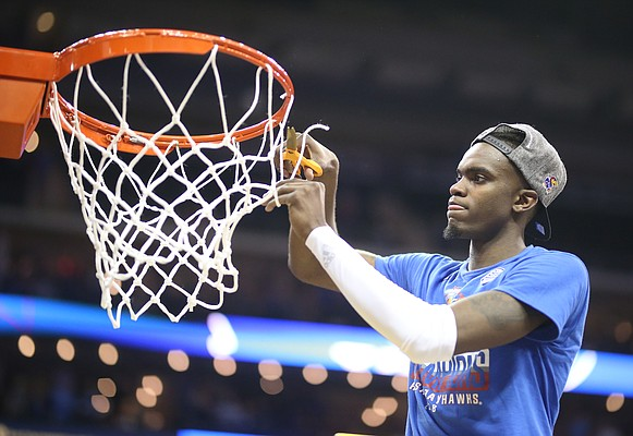 Kansas guard Lagerald Vick (2) cuts a piece of the net following the JayhawksÕ 81-70 win over the Mountaineers in the championship game of the Big 12 Tournament, Saturday, March 10, 2018 at Sprint Center in Kansas City, Mo.