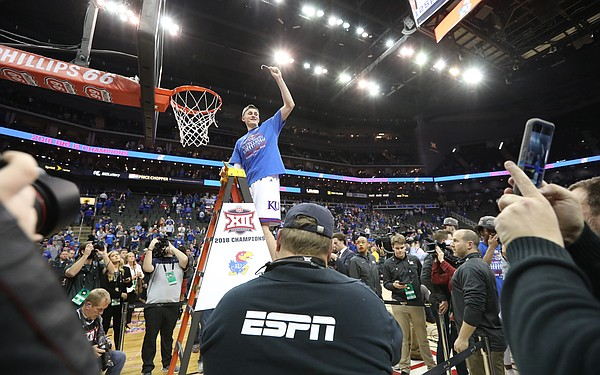Kansas forward Mitch Lightfoot (44) holds up his piece of the net following the JayhawksÕ 81-70 win over the Mountaineers in the championship game of the Big 12 Tournament, Saturday, March 10, 2018 at Sprint Center in Kansas City, Mo.