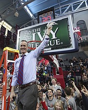 Pennsylvania's head coach Steve Donahue makes the final cut of the net following an NCAA college basketball championship game in the Ivy League Tournament against the Harvard, Sunday, March 11, 2018, in Philadelphia. Penn won 68-65. (AP Photo/Chris Szagola)