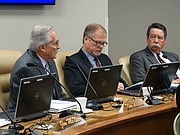 Kansas State Board of Education member Ken Willard, left, discusses the issue of allowing some school employees, including teachers, to carry firearms as part of an effort to ward off mass shootings as board members John Bacon, center, and Steve Roberts listen, Tuesday, March 13, 2018.