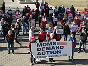 About 100 people took part in a Statehouse rally Wednesday to call for legislative action on gun safety. The rally sponsored by the Kansas chapter of Moms Demand Action for Gun Sense in America was briefly interrupted when an estimated 1,000 students from nearby Topeka High School marched to the Statehouse as part of a nationwide student walkout to protest gun violence.