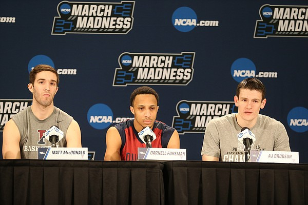 Penn players Matt MacDonald, Darnell Foreman and A.J. Border take questions from media members during a day of practices and press conferences at Intrust Bank Arena in Wichita, Kan.