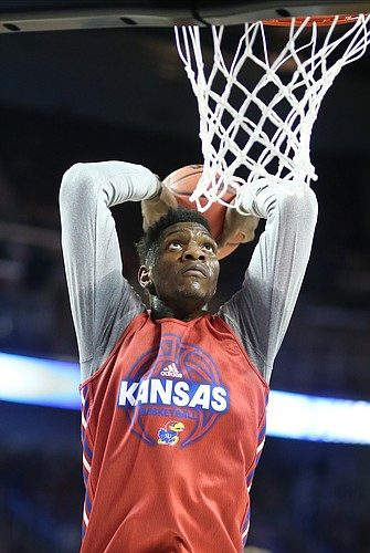 Kansas forward Silvio De Sousa comes in for a dunk during practice on Wednesday, March 14, 2018 at Intrust Bank Arena in Wichita, Kan.