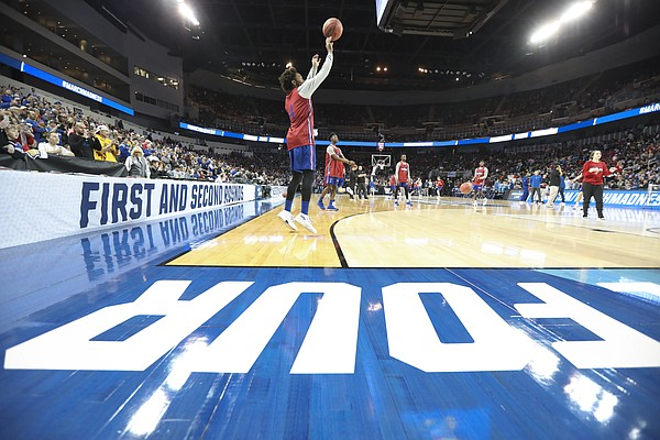 Kansas guard Devonte' Graham puts up a three from the corner during the Jayhawks' practice on Wednesday, March 14, 2018 at Intrust Bank Arena in Wichita, Kan.