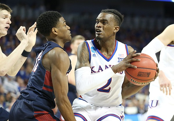 Kansas guard Lagerald Vick (2) gets into the paint as he is defended by Penn guard Devon Goodman (12) during the second half, Thursday, March 15, 2018 at Intrust Bank Arena in Wichita, Kan.
