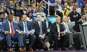 Kansas head coach Bill Self and his assistants watch a shot during the second half, Thursday, March 15, 2018 at Intrust Bank Arena in Wichita, Kan.
