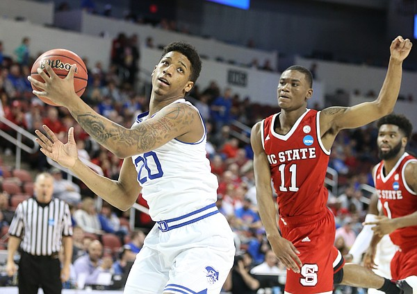 Seton Hall forward Desi Rodriguez (20) catches a pass inside past North Carolina State guard Markell Johnson (11) during the second half, Thursday, March 15, 2018 at Intrust Bank Arena in Wichita, Kan.