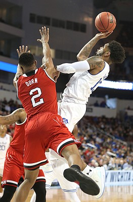 Seton Hall guard Myles Powell puts up a shot against North Carolina State guard Torin Dorn (2) during the second half, Thursday, March 15, 2018 at Intrust Bank Arena in Wichita, Kan.