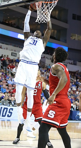 Seton Hall center Angel Delgado (31) comes in for a dunk during the second half, Thursday, March 15, 2018 at Intrust Bank Arena in Wichita, Kan.