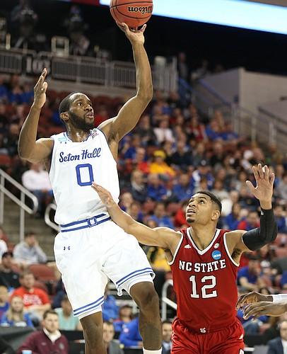 Seton Hall guard Khadeen Carrington (0) puts a shot over North Carolina State guard Allerik Freeman (12) during the second half, Thursday, March 15, 2018 at Intrust Bank Arena in Wichita, Kan.