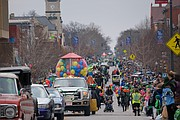 Crowds line Massachusetts Street to take in the Lawrence St. Patrick's Day Parade on Saturday, March 17, 2018.