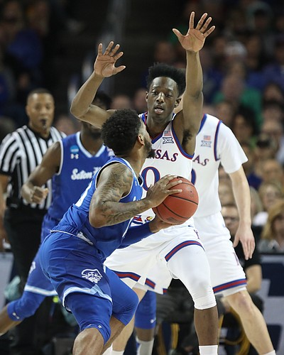 Kansas guard Marcus Garrett (0) defends against Seton Hall guard Myles Powell (13) during the first half, Saturday, March 17, 2018 in Wichita, Kan.