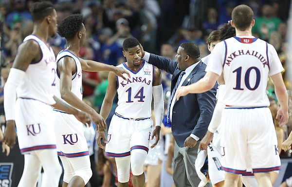 Kansas guard Malik Newman (14) gets a congratulatory pat on the head from assistant coach Jerrance Howard after a late three-pointer during the first half, Saturday, March 17, 2018 in Wichita, Kan.