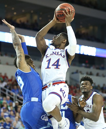 Kansas guard Malik Newman (14) elevates to the bucket against Seton Hall guard Myles Powell (13) during the first half, Saturday, March 17, 2018 in Wichita, Kan.