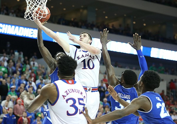 Kansas guard Sviatoslav Mykhailiuk (10) soars in to the bucket during the first half, Saturday, March 17, 2018 in Wichita, Kan.