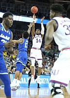 Kansas guard Malik Newman (14) puts a three over Seton Hall guard Myles Powell (13) during the second half, Saturday, March 17, 2018 in Wichita, Kan.