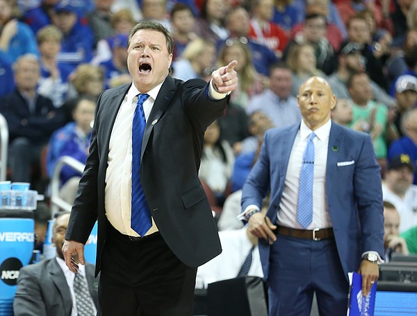 Kansas head coach Bill Self directs his players during the second half, Saturday, March 17, 2018 in Wichita, Kan.