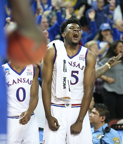 Kansas center Udoka Azubuike (35) goes wild on the bench after a three from Kansas guard Sviatoslav Mykhailiuk late in the second half, Saturday, March 17, 2018 in Wichita, Kan.