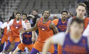 Clemson forward Aamir Simms (25) and the Tigers get warmed up at the start of practice on Thursday, March 22, 2018 at CenturyLink Center in Omaha, Neb.