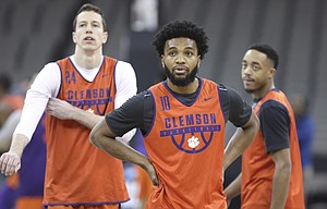 Clemson guard Gabe DeVoe (10), Clemson forward David Skara (24) and Clemson guard Marcquise Reed prepare to run through a drill during a practice on Thursday, March 22, 2018 at CenturyLink Center in Omaha, Neb.