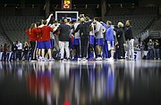 The Kansas Jayhawks come in for a team huddle toward the beginning of practice on Thursday, March 22, 2018 at CenturyLink Center in Omaha, Neb.