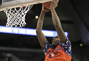 Clemson forward Elijah Thomas comes in for a dunk during practice on Thursday, March 22, 2018 at CenturyLink Center in Omaha, Neb.