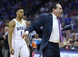 Duke head coach Mike Krzyzewski throws off his jacket in frustration during the second half, Friday, March 23, 2018 at CenturyLink Center in Omaha, Neb.