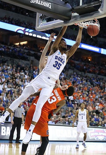 Duke forward Marvin Bagley III (35) throws down a lob jam over Syracuse center Paschal Chukwu (13) during the second half, Friday, March 23, 2018 at CenturyLink Center in Omaha, Neb.